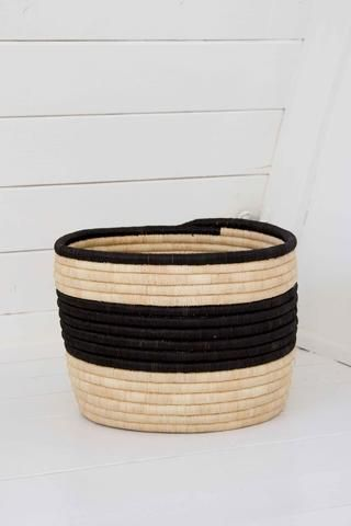 Palm Striped Storage Basket. Handwoven by a cooperative of fair trade artisan…