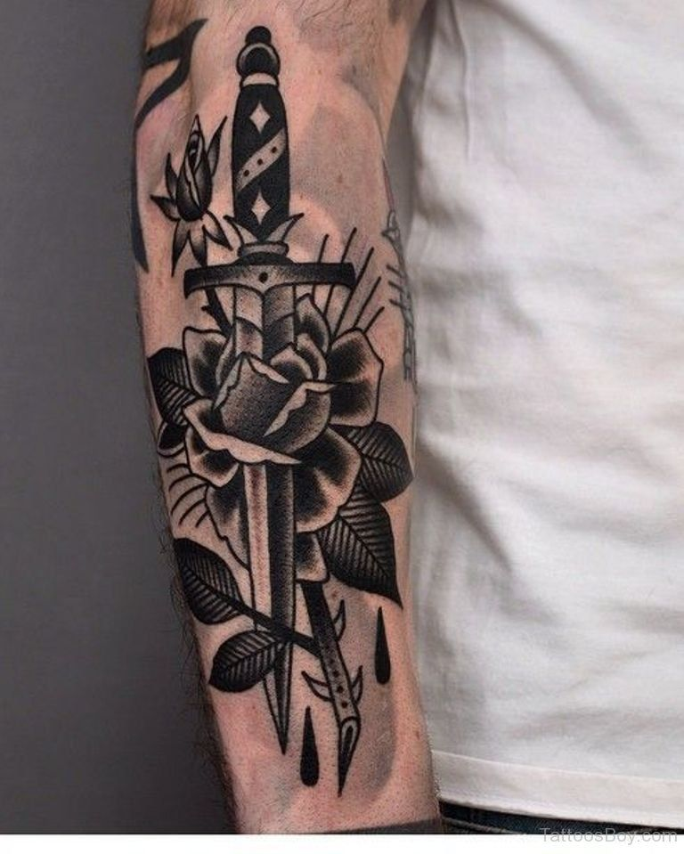 Black Rose And Dagger Traditional Tattoo On Arm Sleeve Tats