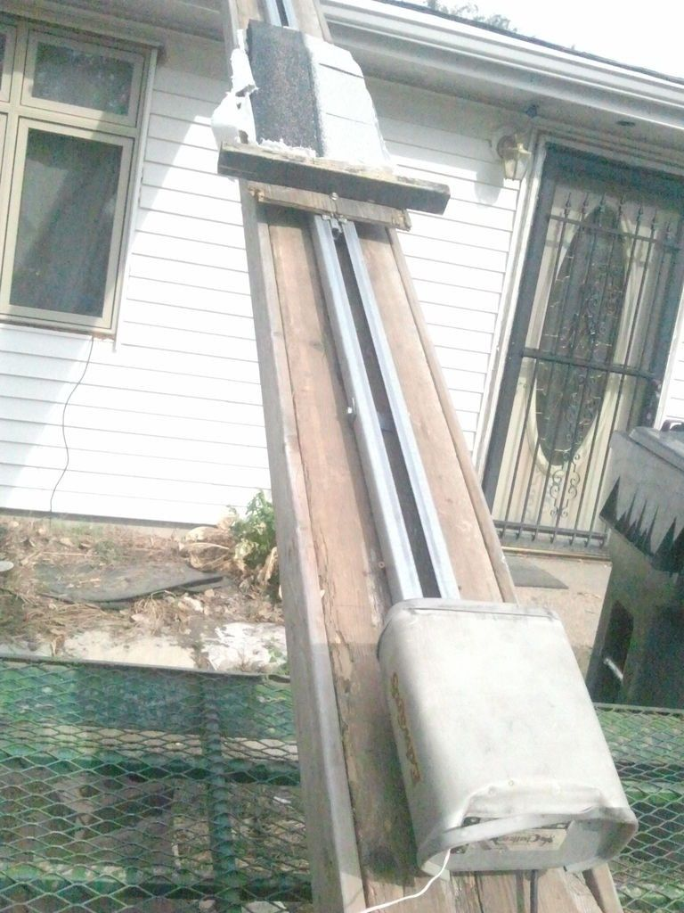 Roofing Escalator by grannyjones -- Homemade roofing escalator powered by a garage door opener. Carriage and supporting ramp were constructed from wood. http://www.homemadetools.net/homemade-roofing-escalator
