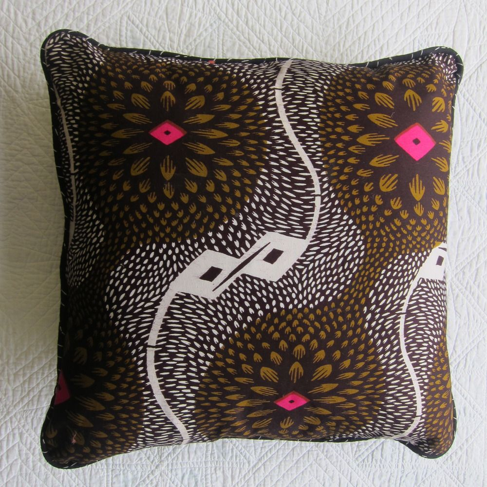 """BDWA """"Wonderlust"""" African wax resist cushion with contrast Indian hand-stitched piping."""