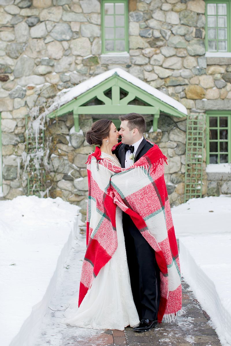Fun winter photo idea bride and groom cozy up with a