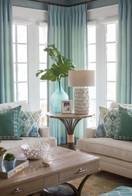 Beach house with light aqua decor and soft neutrals coastal decor pillows