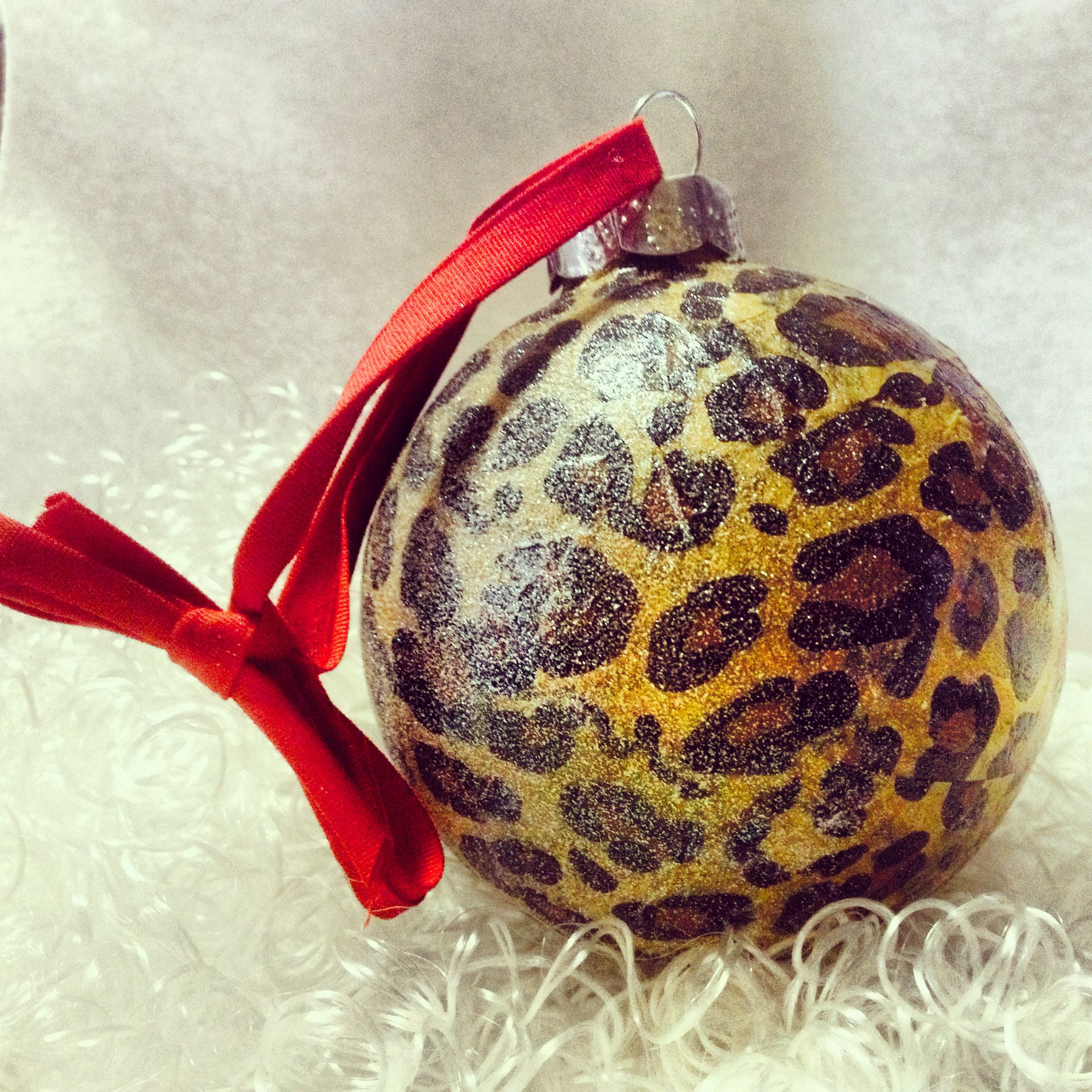 Diy Leopard Print Christmas Ornament Modge Podge Leopard Tissue Paper And Spray Glitter Christmas Crafts Christmas Ornaments Glitter Spray