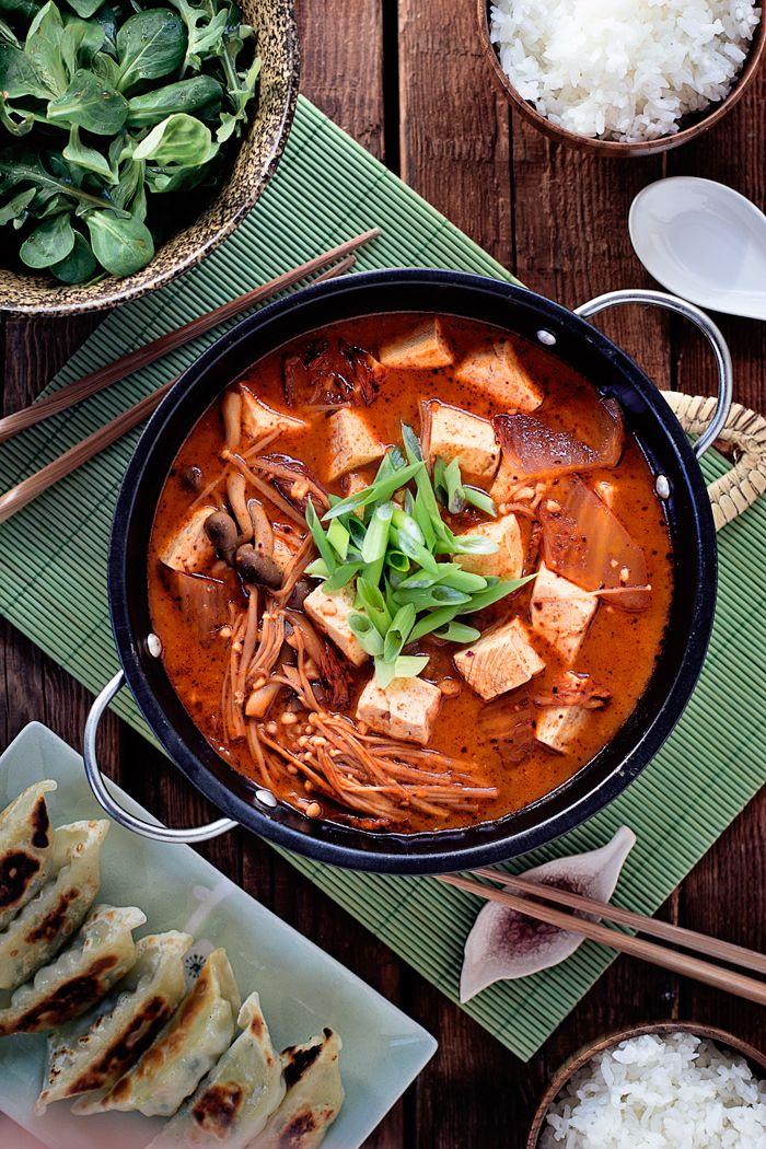 Kimchi Jjigae with Soft Tofu, Vegetable Gyoza, Salad with Japanese Dressing, and Cooked Rice