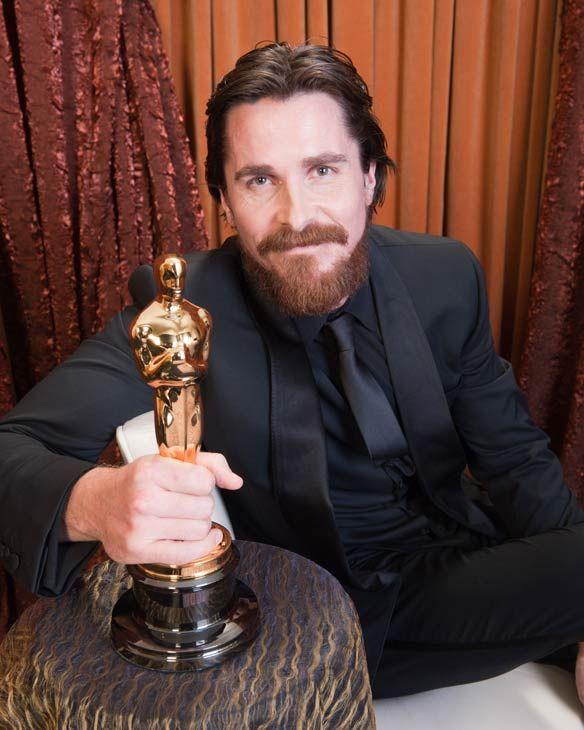 Best Supporting Actor Christian Bale poses backstage during
