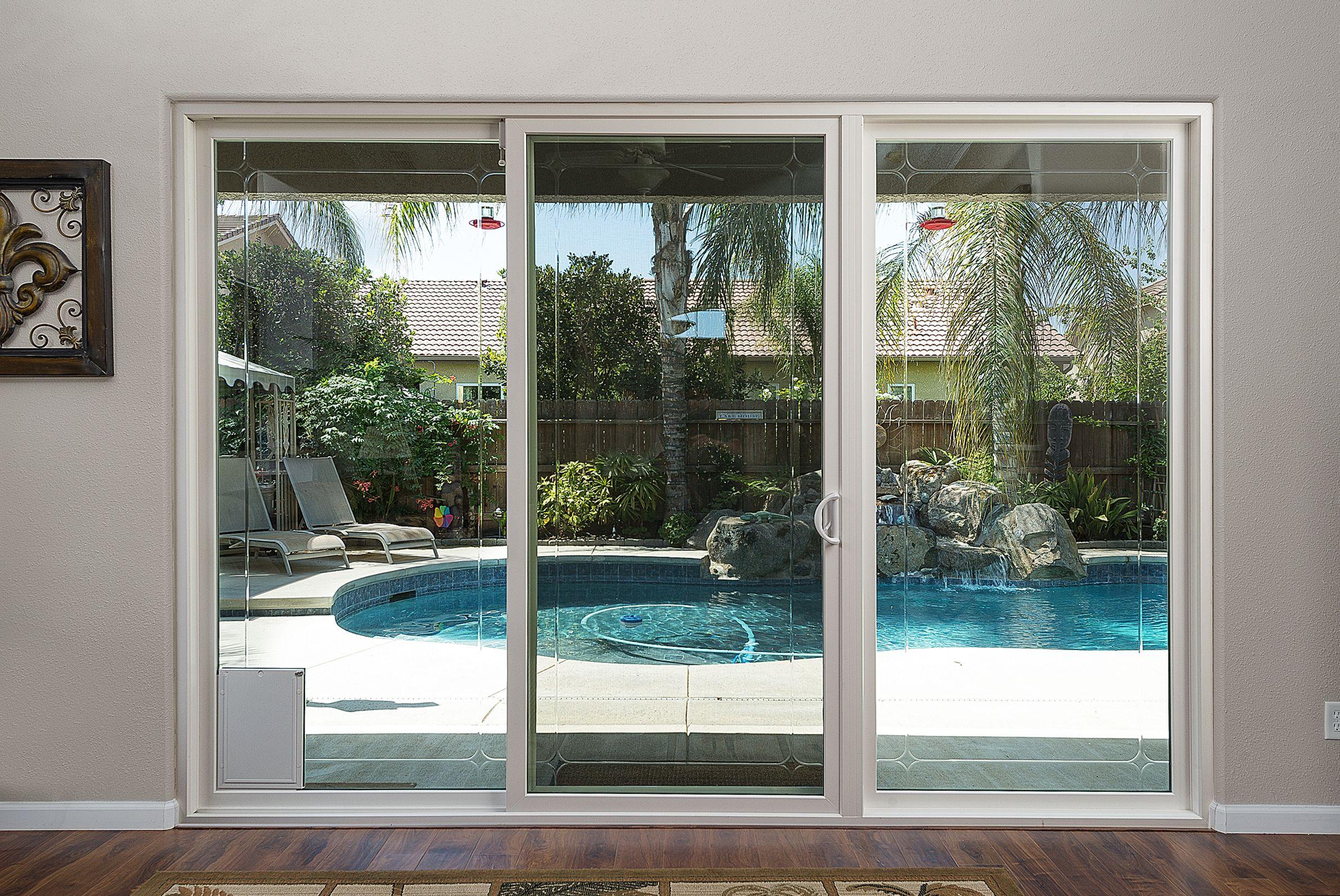 Beautiful View Out Of An Anlin Patio Sliding Door With Freedom Pet Door Option Patio Doors Patio Beautiful Doors