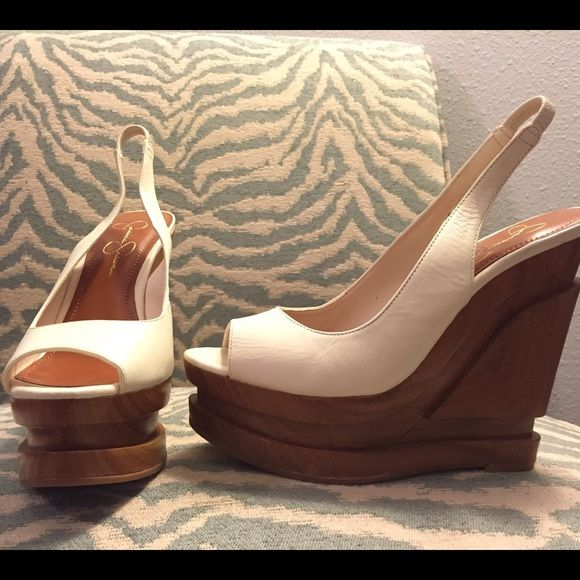 Jessica Simpson Leather and Wooden Platform Wedges Cute pair of white leather and wooden authentic Jessica Simpson wedges. Only worn once, in great condition! From a smoke free home. Jessica Simpson Shoes Wedges