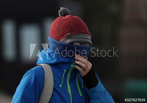 A man covers his face at the Castle Esplanade in Edinburgh , #Sponsored, #face, #covers, #man, #Edinburgh, #Esplanade #Ad
