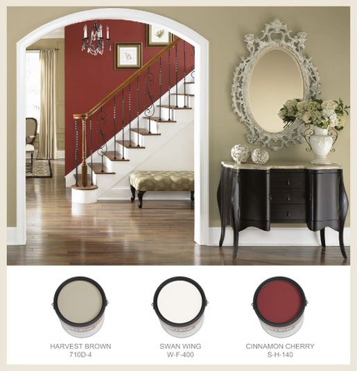 Connecting Spaces - A bright red accent color on the stairway wall shortens the space in a long hallway and transitions from lower level to upper floors.  - See more at: http://colorfullybehr.com/index.php/connecting-spaces/#sthash.GB6lL9oz.dpuf