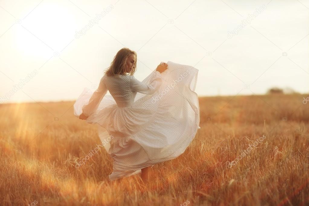Girl Dancing In A Field In White Dress Girl Dancing Stock Photo