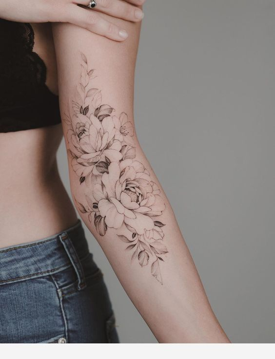 Flower on arm tattoo