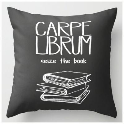 Carpe Librum! I kind of like the idea of a bookish throw pillow that orders me to get back to reading. Not that I usually need much encouragement…but still.