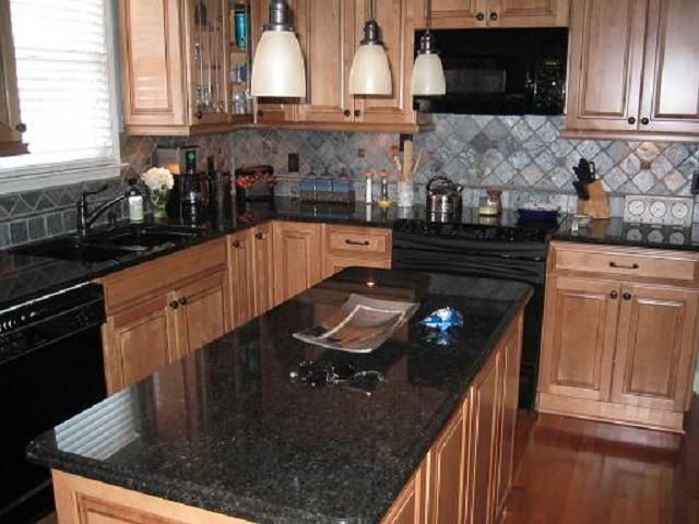 Black granite countertops black pearl is natural granite for Dark kitchen countertops