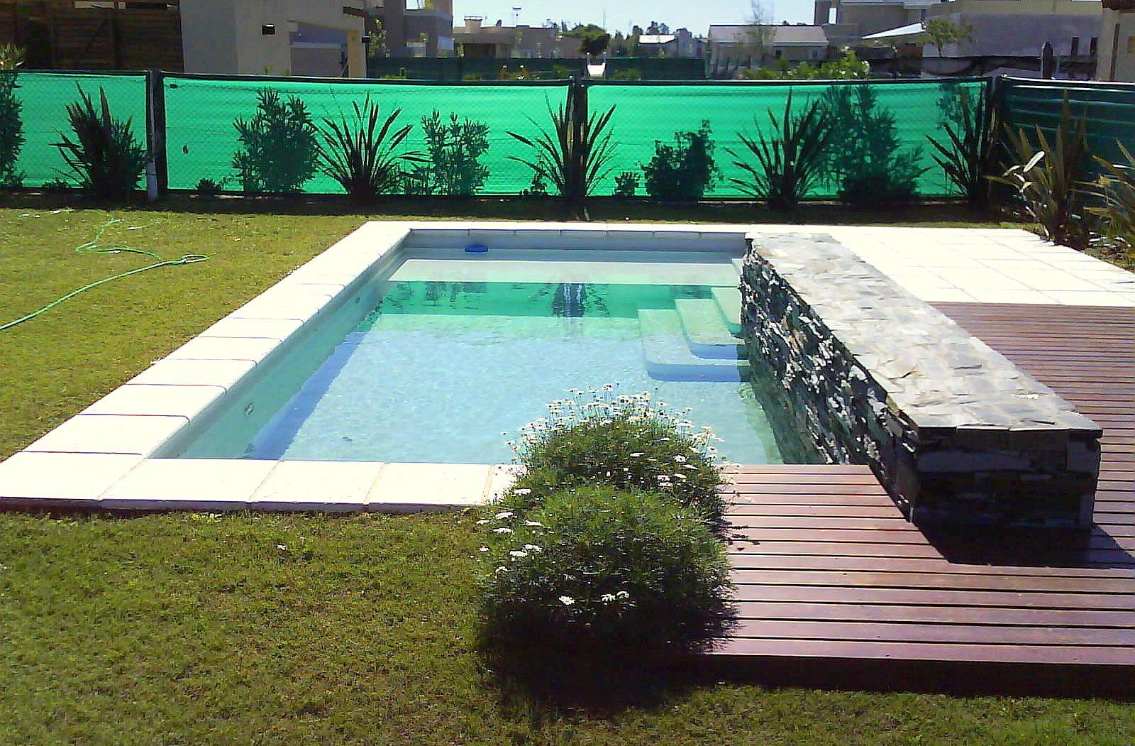Dise o personalizados canteros revestidos en piedra deck - Diseno de piscinas ...