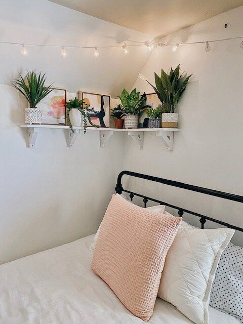 This was such a fun DIY and I share all the steps in this post so you can make one too.   The faux summer plants arranged on the shelf create the perfect warm-weather decor vibe for this boho-glam bedroom.     #prideinthemaking #handmadewithjoann