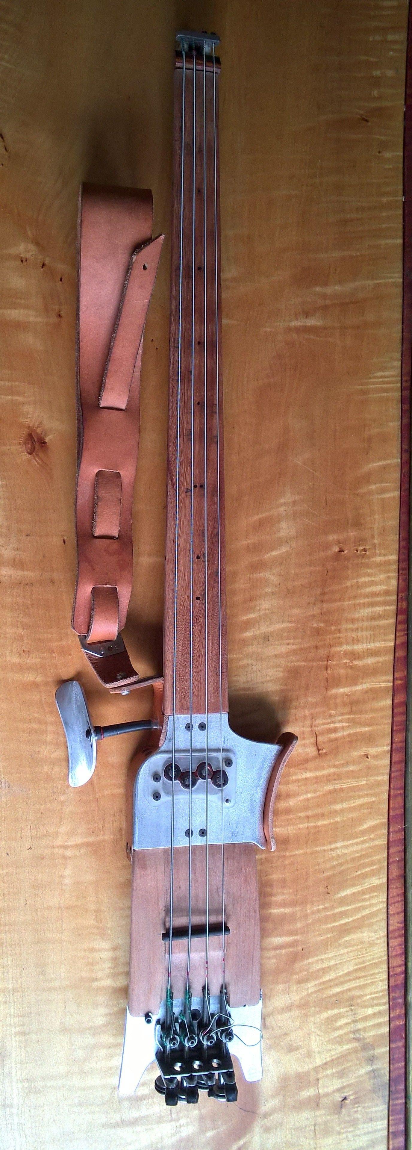 aluminum through neck with ironwood fret board ,soundboard