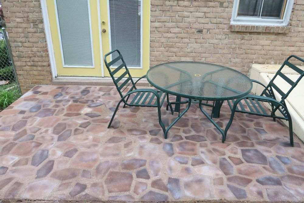How To Fake A Beautiful Stone Patio For Just 50 Patio Stones Flagstone Patio Patio Flooring