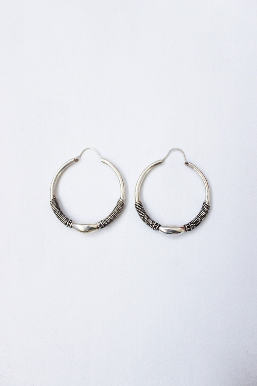 A personal favorite from my Etsy shop https://www.etsy.com/listing/493920119/sterling-hoops-large-banded-vintage-925