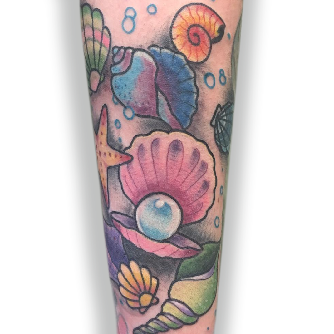 Photo of A color tattoo half sleeve under the sea of pearls and shells done by @NiceJe