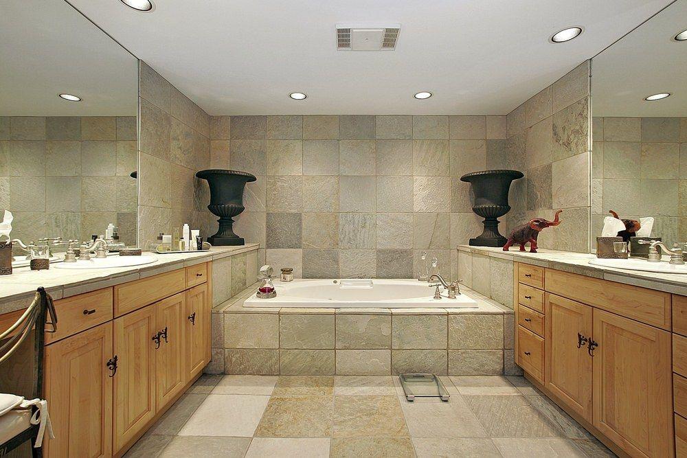 Small bathroom flooring ideas with mixed antique tiles