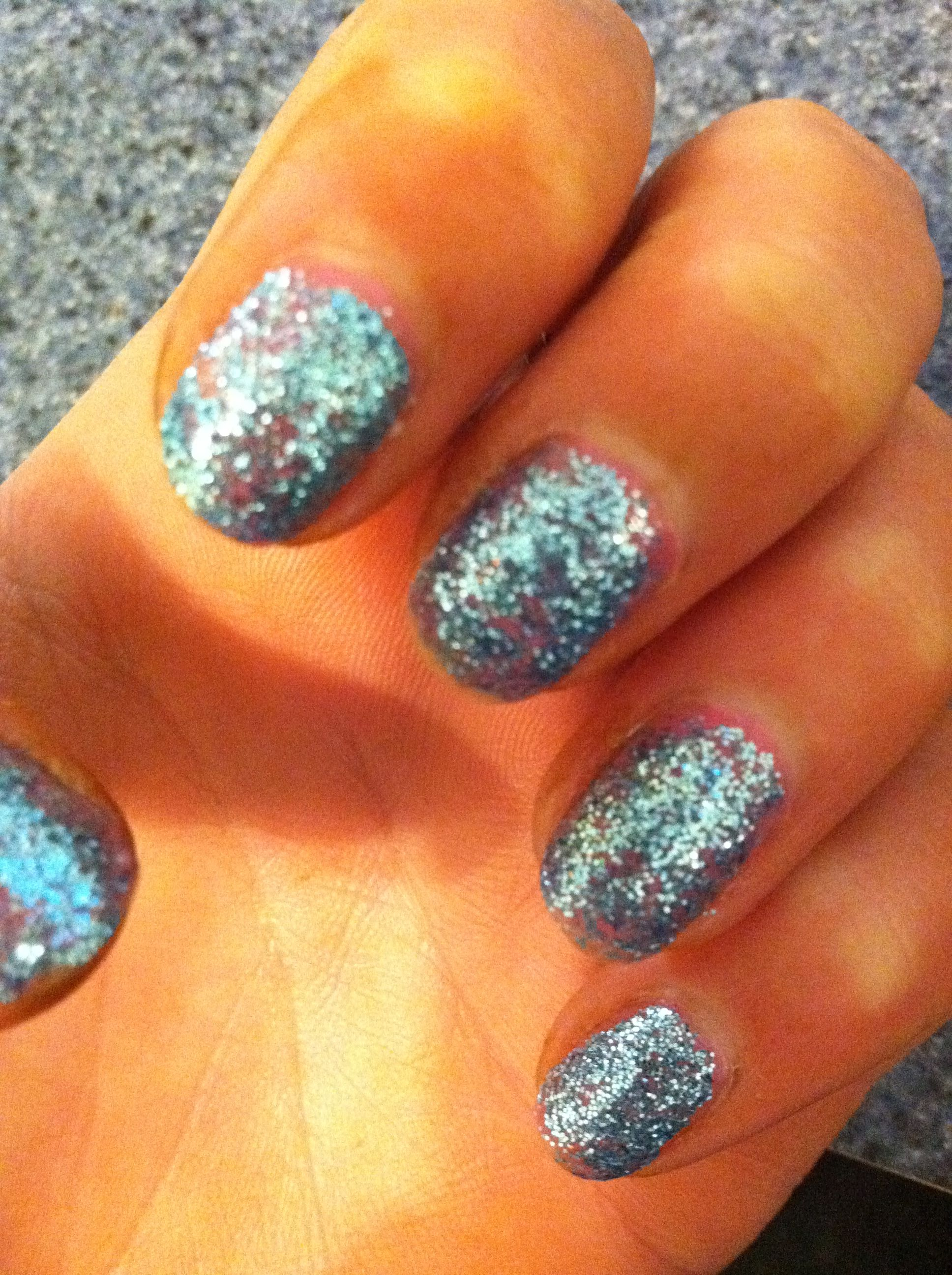 Light Pink Nail Polish Under Blue Sparkle Eye Shadow Mixed With Clear