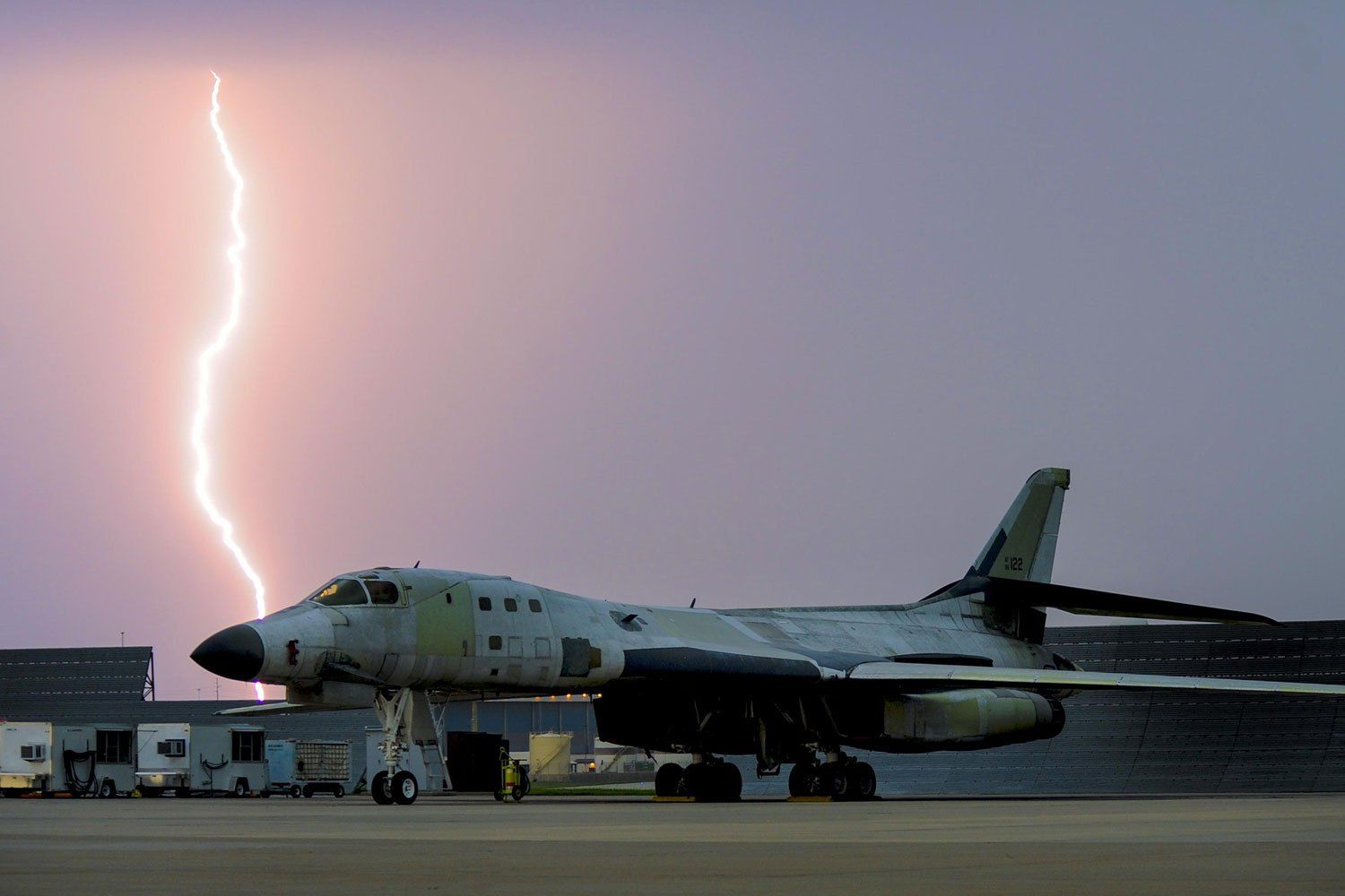 Lightning strikes behind a B1B Lancer Air Force