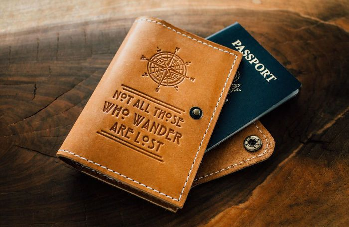 25 One-Of-A-Kind Gift Ideas For People Who Love Traveling - A leather cover for your passport that sports a famous quote from Lord of the Rings that many travelers can relate to.
