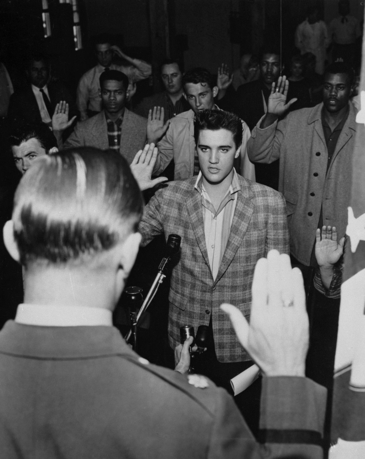 Elvis Presley (center) at his induction into the US Army