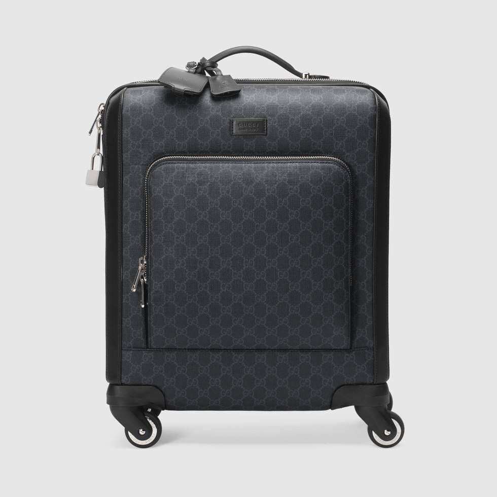 d903d126b29e Shop the GG Supreme suitcase by Gucci. A compact four wheel carry-on made