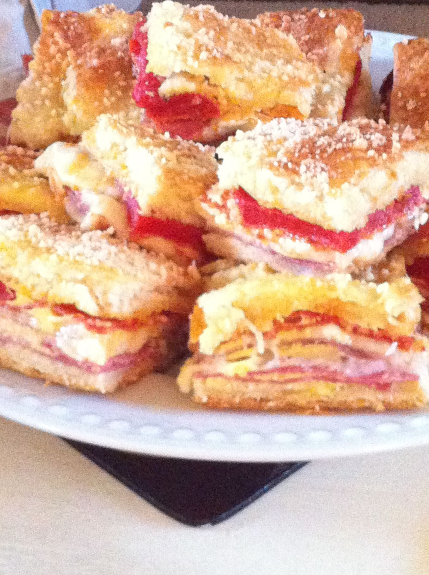 Antipasto squares--The main players are a variety of deli meats and cheese layered between a crescent roll crust. But what takes it over the top are the roasted red peppers that are sliced thin and layered haphazardly just below the top crust. #antipastosquares Antipasto squares--The main players are a variety of deli meats and cheese layered between a crescent roll crust. But what takes it over the top are the roasted red peppers that are sliced thin and layered haphazardly just below the top c #antipastosquares
