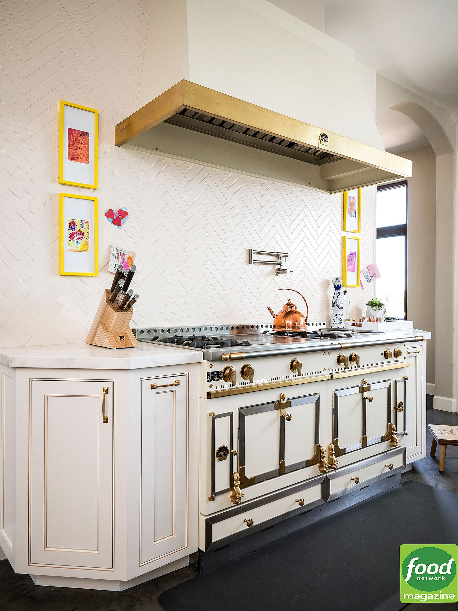 Inside Ayesha Curry\'s Bright White Kitchen with Golden Accents ...