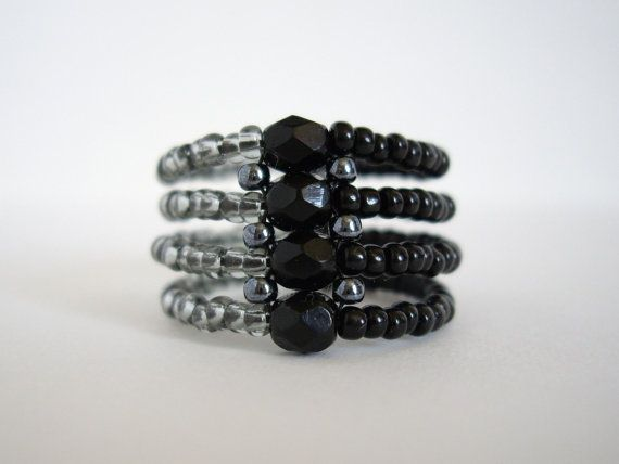 This is an elegant peyote ring. I have used Japanese seed beads in black, gunmetal and black diamond. I have also used 4mm jet black firepolish. It