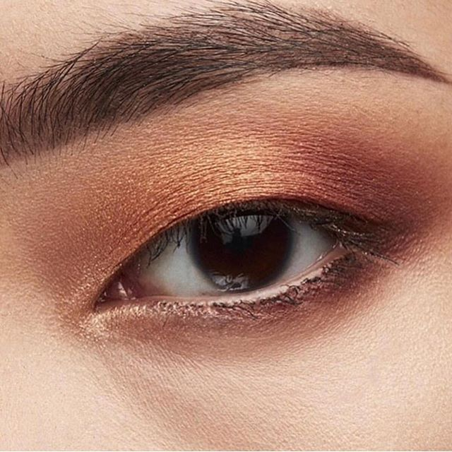 Natural looking eye makeup with touch of gold