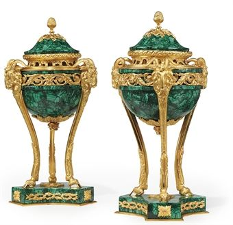 A PAIR OF GILT-BRONZE BRULE PARFUMES OF LOUIS XVI STYLE, EARLY 20TH CENTURY, LATER MALACHITE VENEERED The censors with triform ram's head monopodiae 16 in. (40.6 cm.) high (2)