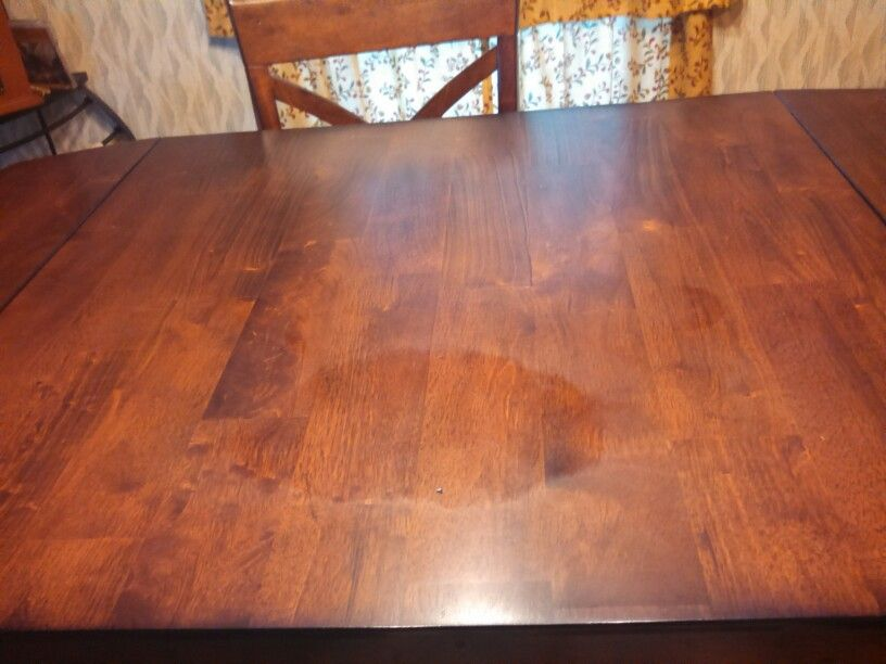 Wood table that picked up strange marks. I have tried many things. Its a new table. I am still paying on it lol.