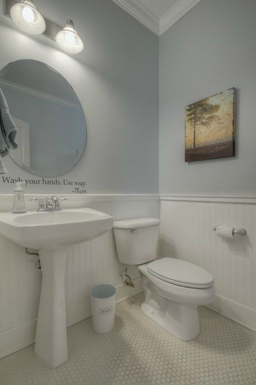 Contemporary Powder Room With Wainscoting Crown Molding