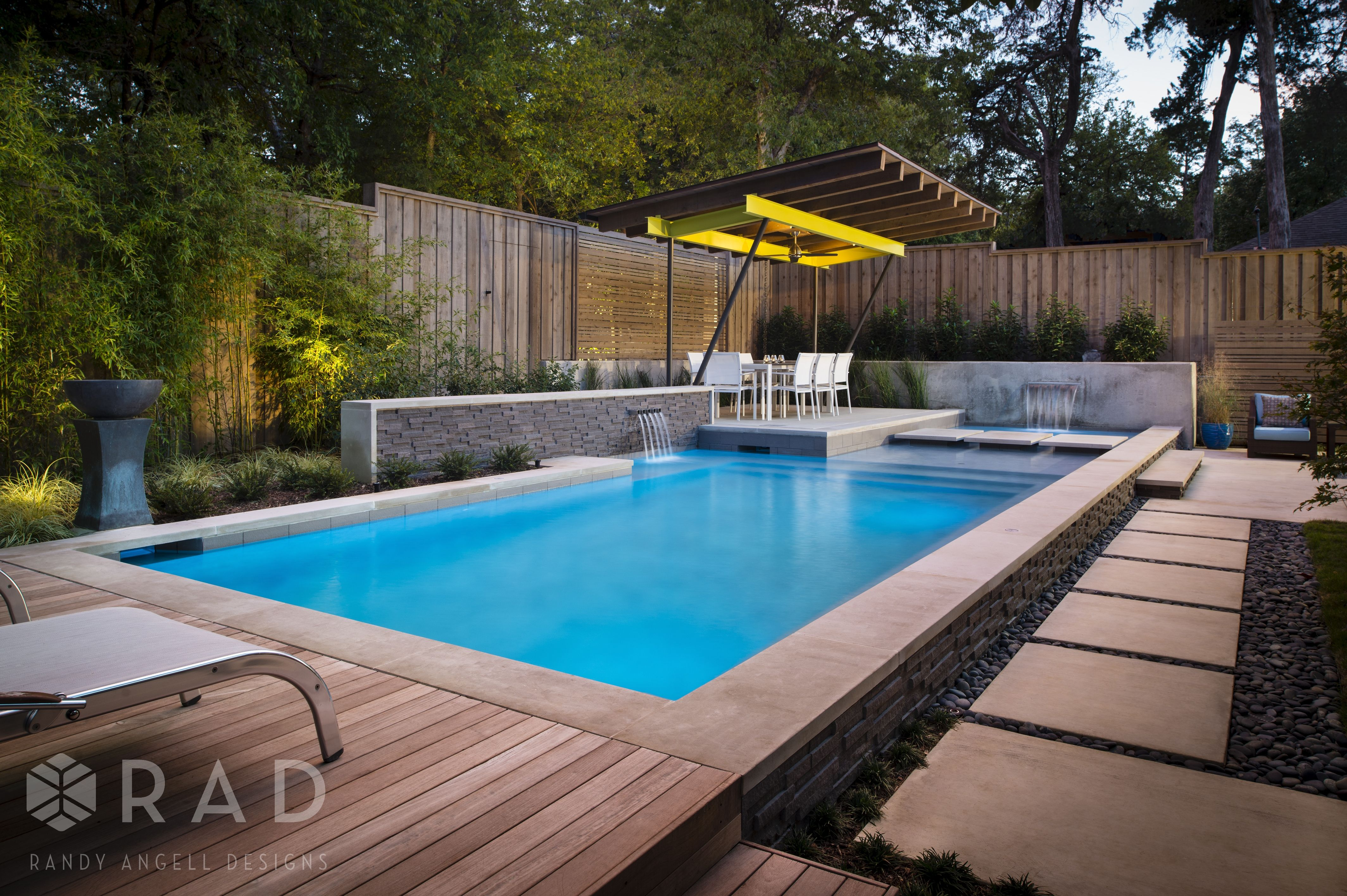 Modern Linear Swimming And Spa Design By Randy Angell Designs Features A Raised Pool Beam With A Grey Le Outdoor Pool Pool Environment Pool Landscape Design