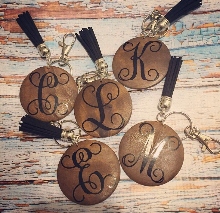 Beautiful Monogrammed Key Tassles Using Wood Cookies Stabilize Them And Prepare Them First With Pentacry Vinyl Monogram Monogram Jewelry Cricut Projects Vinyl