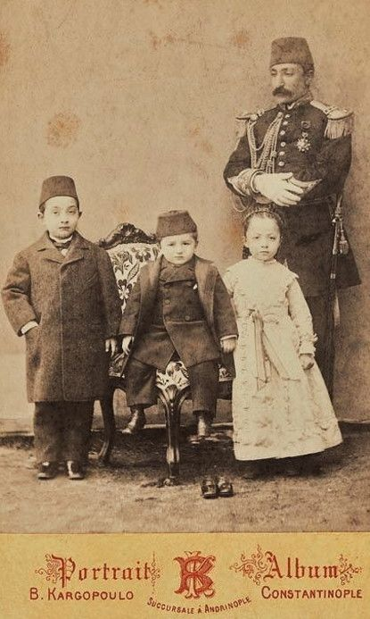 Two little princes and one 'sultane' (princess), and their 'lala' (educator).  Late 19th century.