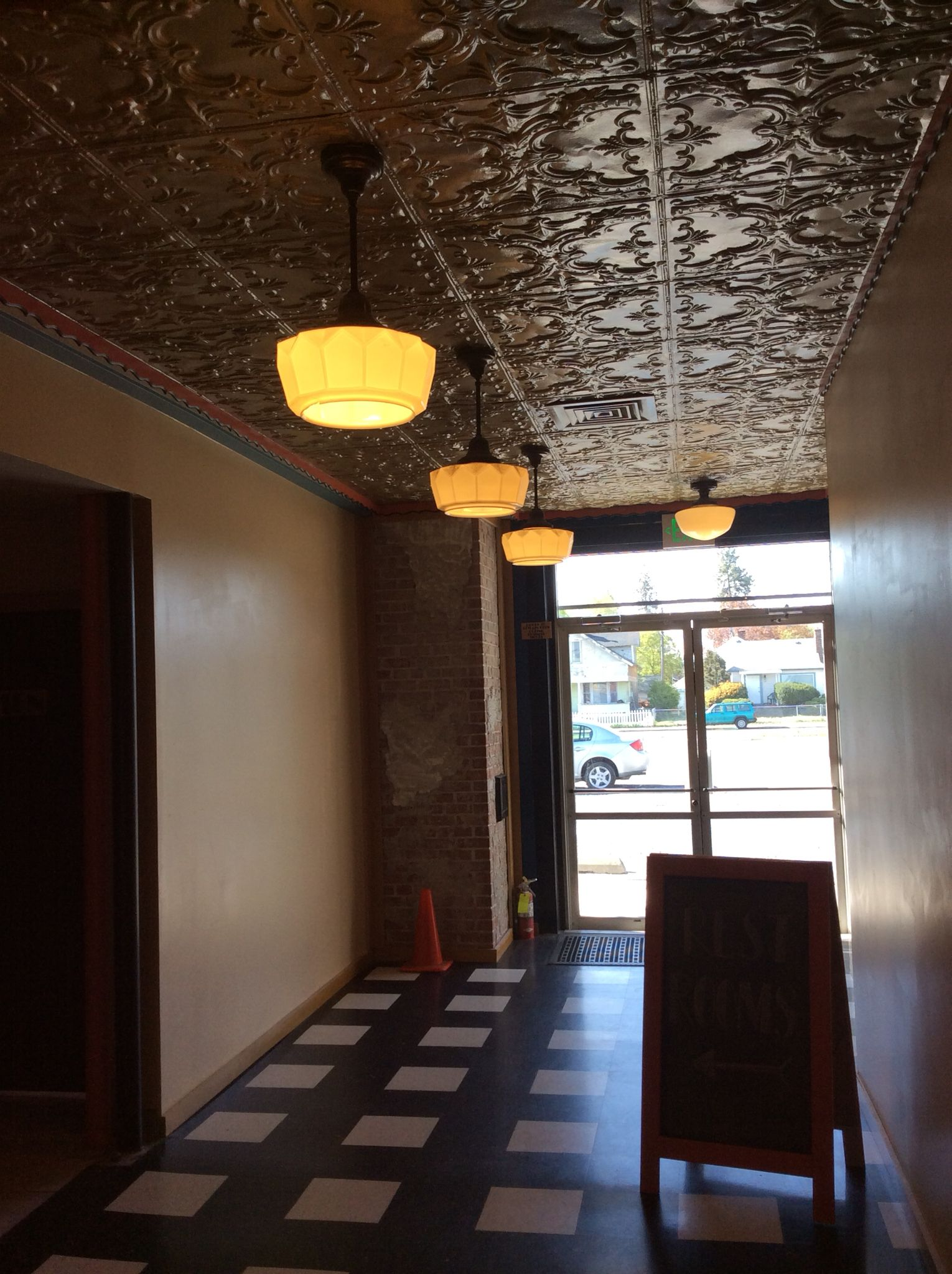 We Preserved The 1940 S Tin Ceiling And Original Light Fixtures Tin Ceiling Light Fixtures Coffee Shop