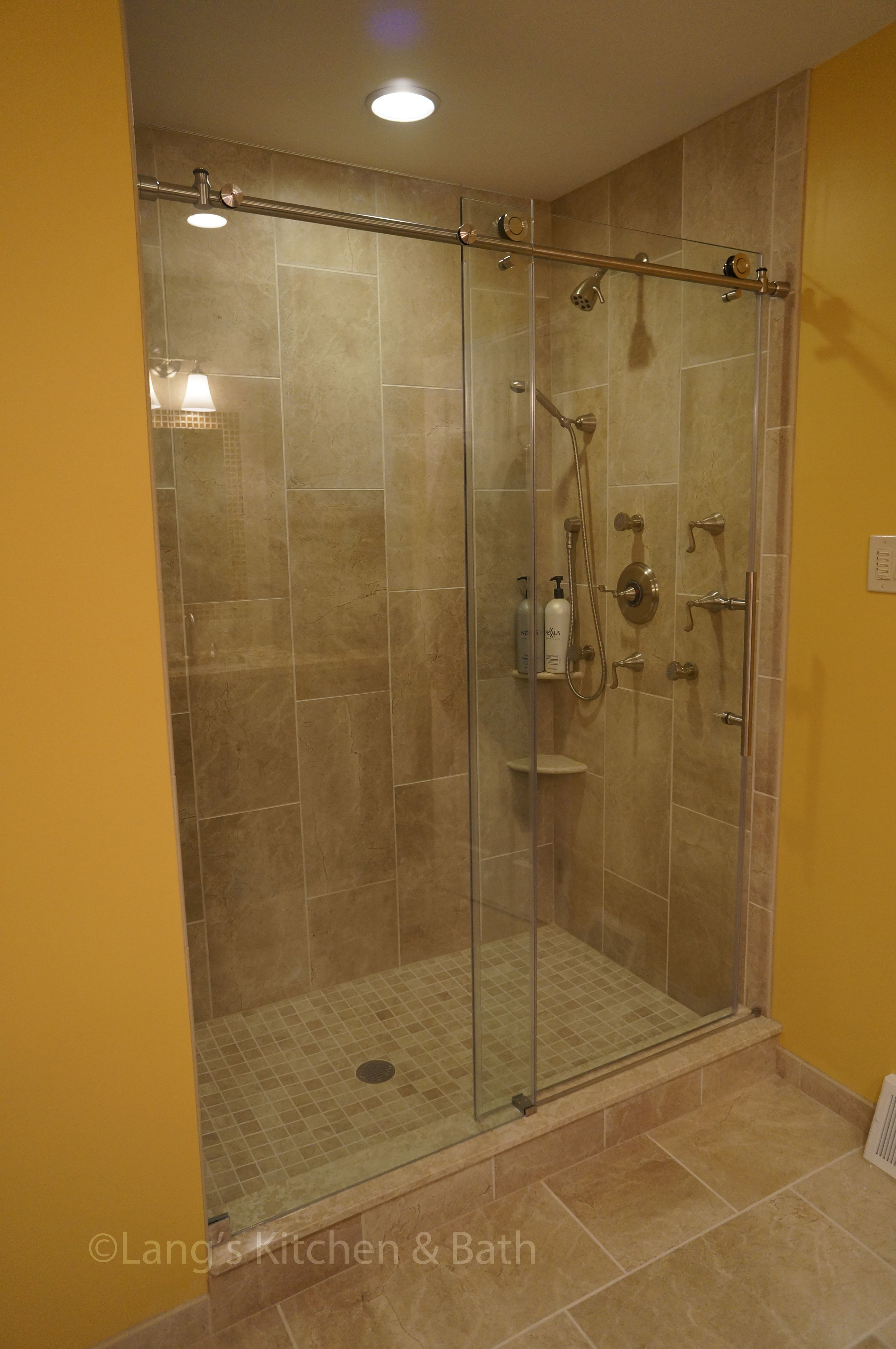 An Extra Large Shower With A Dreamline Rolling Shower Door Is A