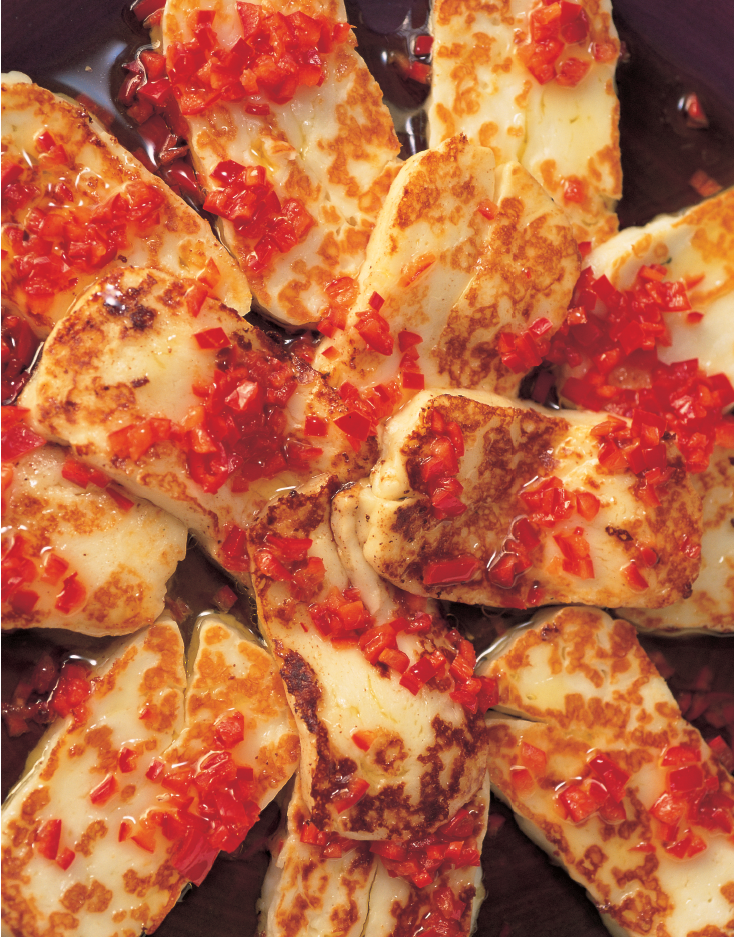 Halloumi with Chilli from Nigella Lawson's Nigella Bites cookbook. This delicious vegetarian recipe can be grilled on the barbecue or simply fried in a pan. This is the sort of food that you can sit on the table for people idly to eat as they stand around, drink in hand. It looks beautiful, too, which is always an aid to proceedings.
