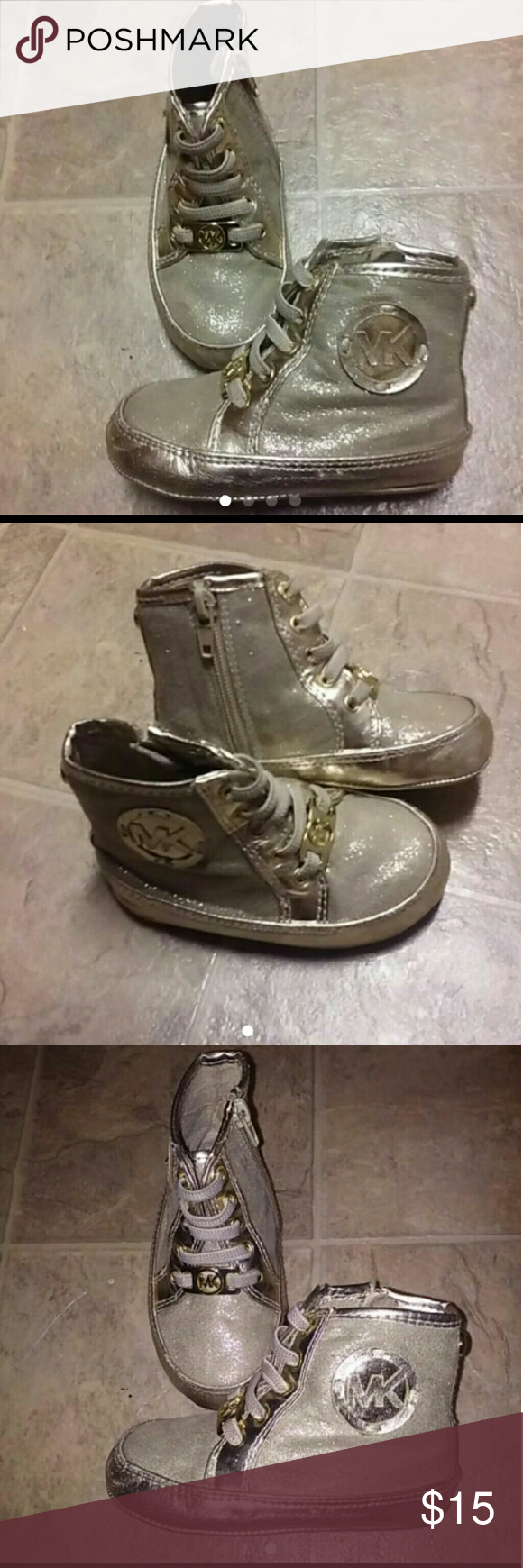 Michael Kors 4c Gold Boots Gold Michael Kors zip-up boots size 4c. In great condition only worn a couple times before my daughter outgrew them. Michael Kors Shoes Boots