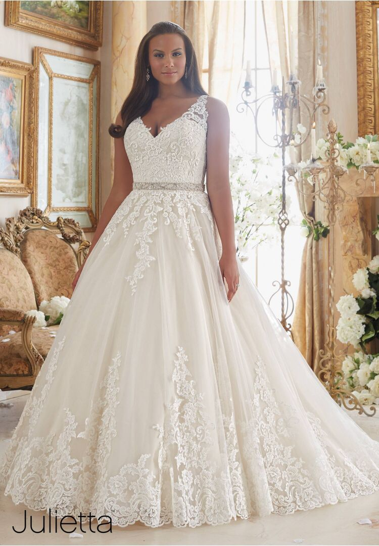 A-line with a little extra volume. Beautiful lace details ...