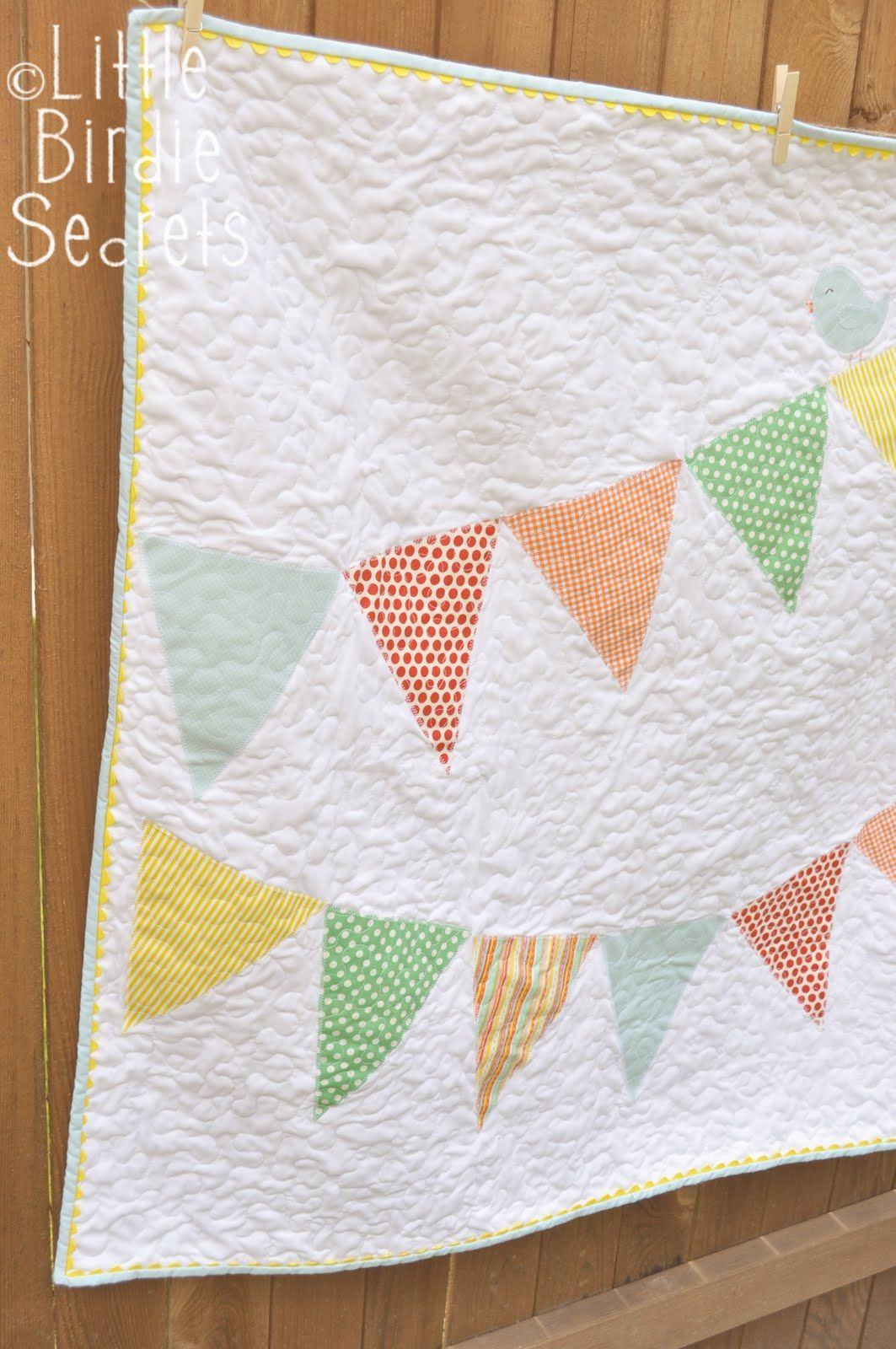 It's finally done! I made this simple banner (bunting) quilt for ... : quilted baby bunting - Adamdwight.com