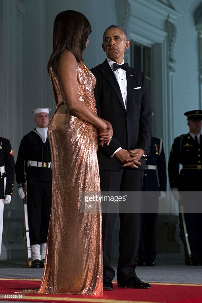 US President Barack Obama (R) and First Lady Michelle Obama (L) wait to greet Italian Prime Minister Matteo Renzi and Italian First Lady Agnese Landini prior to the state dinner at the White House on October 18, 2016 in Washington DC. President Obama and First Lady Michelle Obama are hosting their final state dinner featuring celebrity chef Mario Batali and singer Gwen Stefani performing after dinner.