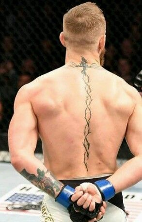 This Spine Tattoo Is Very Attractive And Simple You Should Try