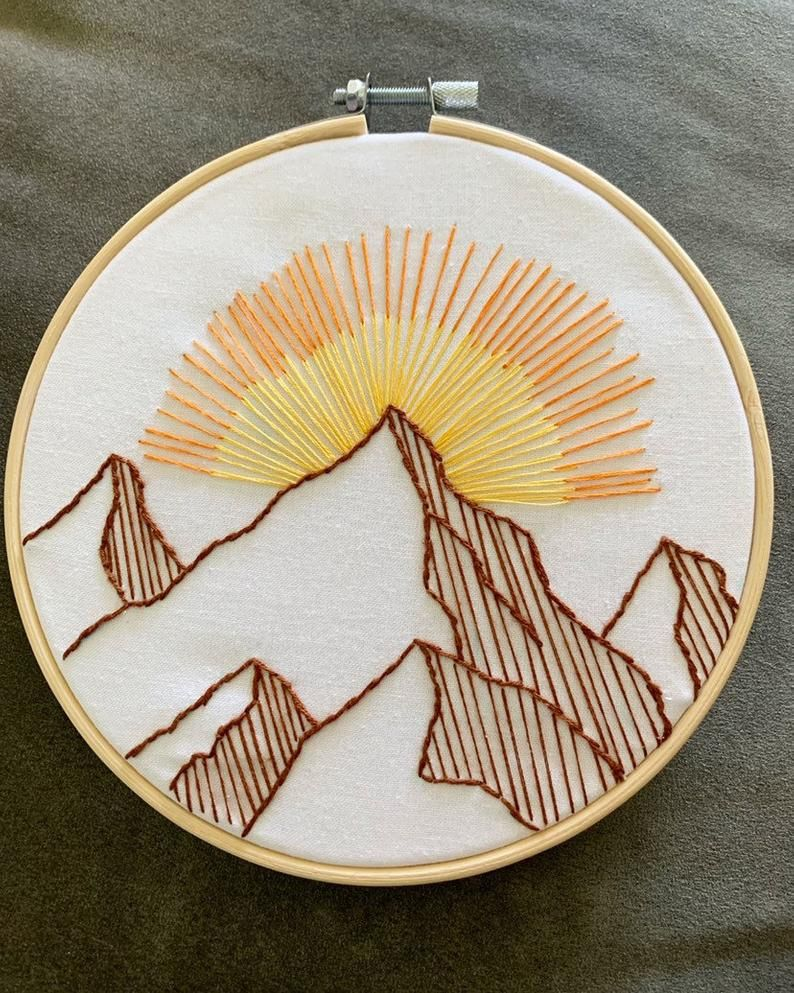 Handmade embroidered mountains and sun – 6″ embroidery hoop art