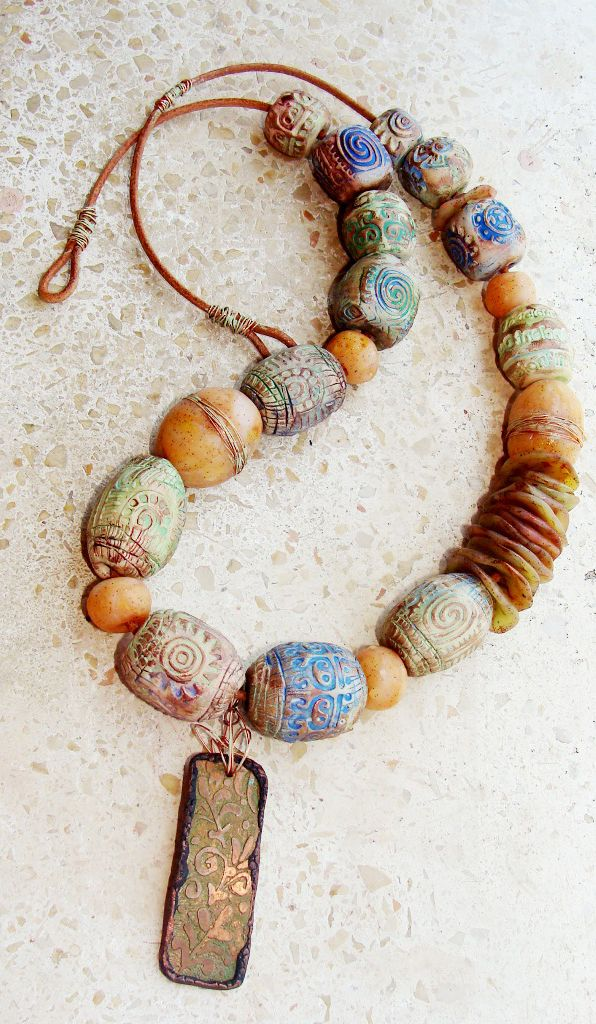 Brown and beige clay artisan beads from Moscow on a textured leather band
