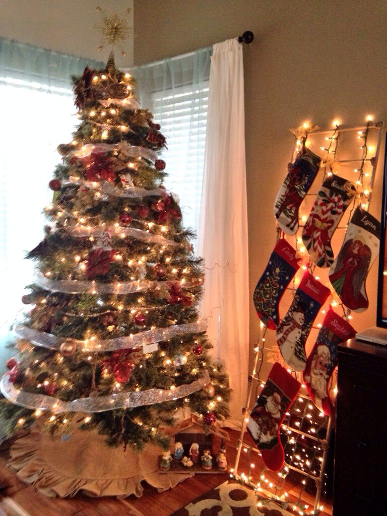 Solution for hanging stockings without a fireplace or mantle. String lights wrapped around a ...